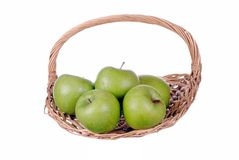 Green apples in a straw basket Stock Images