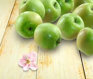 Green apples on the table Stock Photos