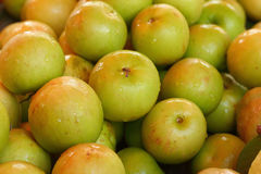Green apples on a table at the market Royalty Free Stock Photography