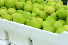 Green apples on a table at the market Royalty Free Stock Photos