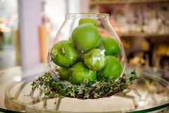 Green apples on table in vase Stock Images