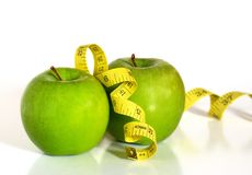 Green apples and tape measure Royalty Free Stock Photos