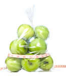 Green apples with tape measurment i Stock Images