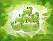 Green apples on triangle background Royalty Free Stock Images