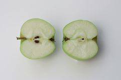 Green apples. The two halves of the apple royalty free stock photo