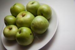 Green apples under contrast lightning Stock Images