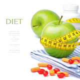 Green apples, vitamins and measuring tape. Diet concept Royalty Free Stock Photography