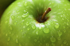 Green apples with water drop close up Royalty Free Stock Images