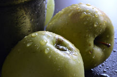 Green apples. With water drops on a dark background Stock Photos