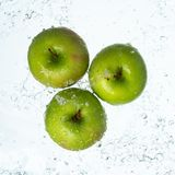 Green apples with water splash stock photo