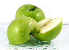 Green apples with waterdrops. On table Royalty Free Stock Photography