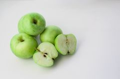 Green apples. On a white backbround royalty free stock photos