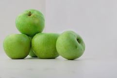 Green apples. On a white background stock photos