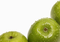Green apples on white background close up detail Royalty Free Stock Images