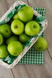 Green apples in white basket Stock Image