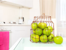 Green apples on the  white kitchen Stock Images