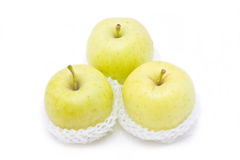Green apples in white packaging. Stock Images