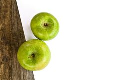 Green apples and white paper Royalty Free Stock Photo