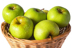 Green apples in a wicker basket Royalty Free Stock Photo