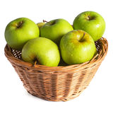 Green apples in a wicker basket Stock Images