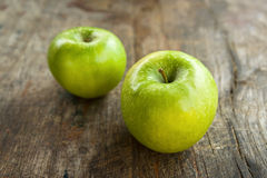 Green apples on wood table. Green apples on old wood table, obsolete wooden texture Stock Photos