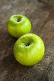 Green apples on wood table Royalty Free Stock Images