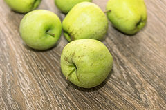Green apples. On a wooden background Royalty Free Stock Photo