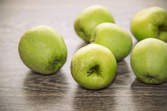 Green apples. On a wooden background Stock Photography