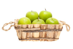 Green apples in a wooden basket Royalty Free Stock Photography