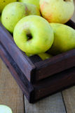 Green apples in a wooden crate Royalty Free Stock Images