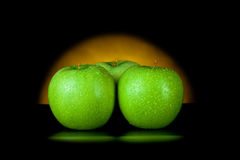 Green apples in yellow light Stock Photography