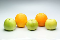 Green appless and oranges. Royalty Free Stock Photos