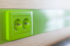 Green appliance receptacle for charging Stock Image