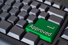 Green approved button. On black keyboard Royalty Free Stock Images