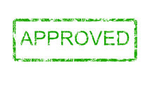 Green Approved rubber stamp. The word approved in a grunge rubber stamp style in the colour green. Suitable for 'save the earth' type campaigns Royalty Free Stock Image