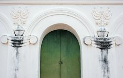 Green Arch door. In white wall royalty free stock photography