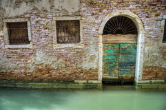 Arched doorway on a canal, Venice, Italy Stock Photos