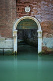 Arched doorway on a canal, Venice, Italy Royalty Free Stock Photography
