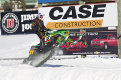 Green Arctic Cat Sno Pro Snowmobile Racing. EAGLE RIVER, WI - MARCH 2:  Green Arctic Cat Sno Pro Snowmobile Racing during a race on March 2, 2013 in Eagle River Royalty Free Stock Photo