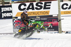 Green Arctic Cat Sno Pro Snowmobile Racing Fast. EAGLE RIVER, WI - MARCH 2:  Fast moving Green Arctic Cat Sno Pro Snowmobile Racing during a race on March 2 Stock Photography