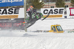 Green Arctic Cat #720 Snowmobile Coming in for Landing. EAGLE RIVER, WI - MARCH 2:  Green Arctic Cat #720 Snowmobile coming in for landing during a race on March Stock Image