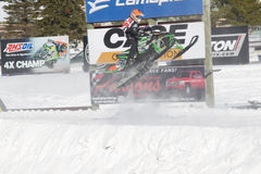 Green Arctic Cat #720 Snowmobile Flying High. EAGLE RIVER, WI - MARCH 2:  Green Arctic Cat #720 Snowmobile Flying High during a race on March 2, 2013 in Eagle Stock Image