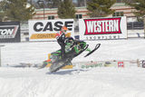 Green Arctic Cat #720 Snowmobile Landing from Jump. EAGLE RIVER, WI - MARCH 2:  Green Arctic Cat #720 Snowmobile landing from jump during a race on March 2, 2013 Royalty Free Stock Photo