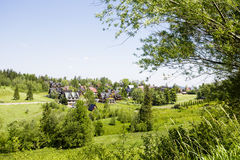 Green areas and houses in the town of Zakopane Stock Images