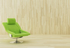Green armchair. In a wooden room Stock Photography