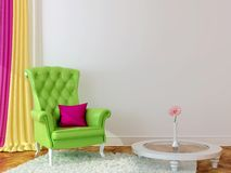 Green armchair in the interior Royalty Free Stock Photos