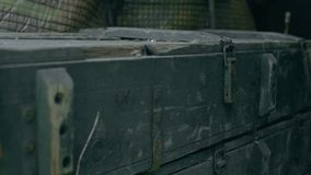 Green army box lies among the dump. Close-up stock footage
