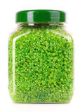 Green aromatic bath salt in bottle isolated Stock Photo