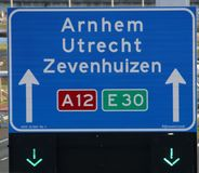 Green arrow above the driving lane indicating that its open on motorway A12 E30 heading Arnhem, utrecht and Zevenhuizen. Green arrow above the driving lane royalty free stock photo