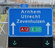 Green arrow above the driving lane indicating that its open on motorway A12 E30 heading Arnhem, utrecht and Zevenhuizen. And junction 8 to N209 local road to royalty free stock photography